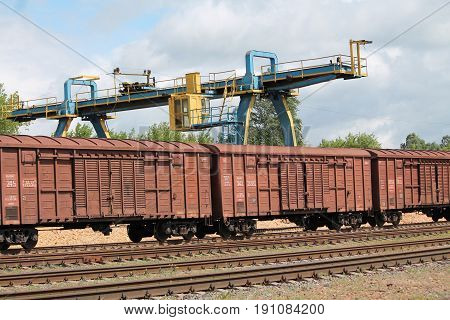 brawn metal wagons stay under crane prepare for loading and supply goods
