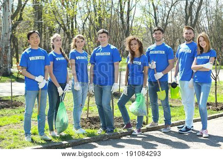 Group of volunteers in park on sunny day