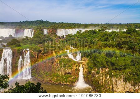 Boiling water creates rainbow. Iguazu Falls - grandiose complex of waterfalls on the border of  Brazil, Argentina and Paraguay. The concept of extreme and exotic tourism