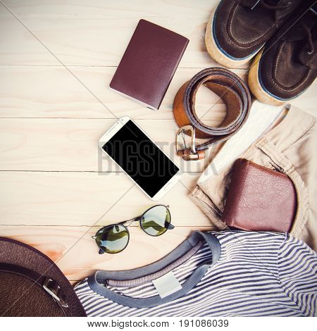 Casual clothing and accessories on the wooden background.