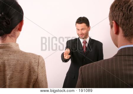 Hadsome Business Man Pointing At Woman - 1