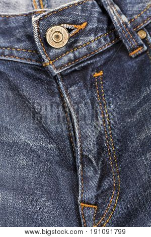 Jeans rivet blue jeans macro photo. Fashion jeans button. bronze part of button. Blue denim