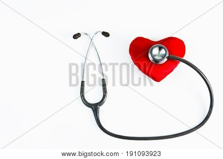 Red heart and stethoscope on white background, medical care concept, selective focus, copy space