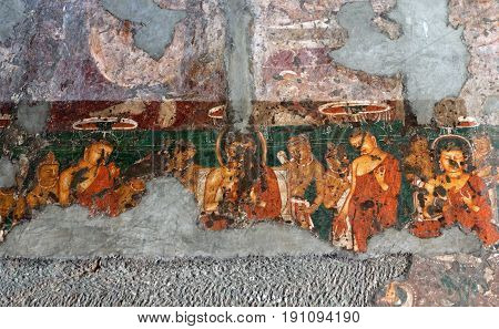 AJANTA, INDIA - JANUARY 10, 2016: Ancient painted fresco in Ajanta caves. The Ajanta in Maharashtra state are about 30 rock-cut Buddhist cave monuments.