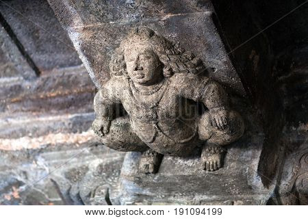 Stone figure of Bharvahaka Yaksha in Ajanta caves, India. The Ajanta Caves in Maharashtra state are about 30 rock-cut Buddhist cave monuments, which date from the 2nd century BCE to about 480 or 650 CE.