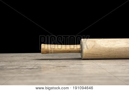 Close up shot of a rolling pin on table