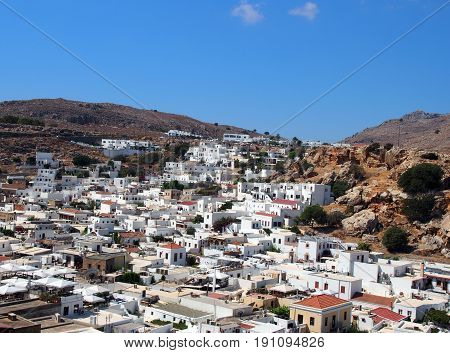 arial panoramic view of afandou village in rhodes with blue sky and mountains