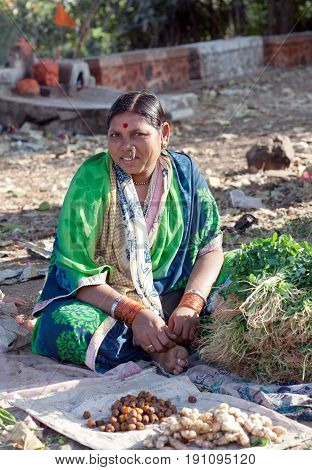 MAHARASHTRA, INDIA - JANUARY 10, 2016: Indian woman selling vegetables at local market