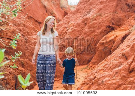 Mother And Son Travelers In Red Canyon Near Mui Ne, Southern Vietnam. Traveling With Children Concep