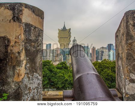 Cannon pointing at Grand Lisboa building Macau