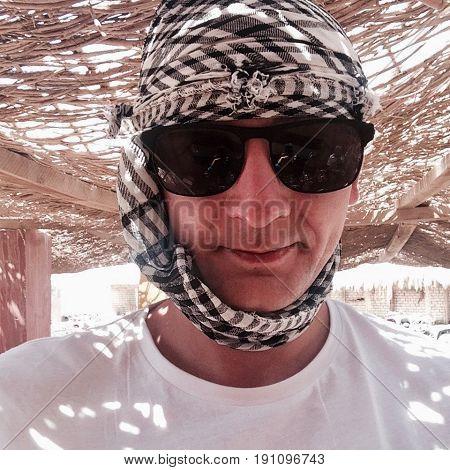 White man in sun glasses on safari in Egypt - Hurghada. Sun Travel.