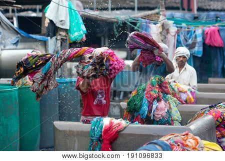 Indian Workers Washing Clothes At Dhobi Ghat In Downtown Of Mumbai, Maharashtra, India