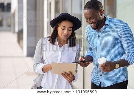 I got some notes. Creative genuine remarkable girl sharing her vision on how their business looking like while having a fruitful discussion with her friend