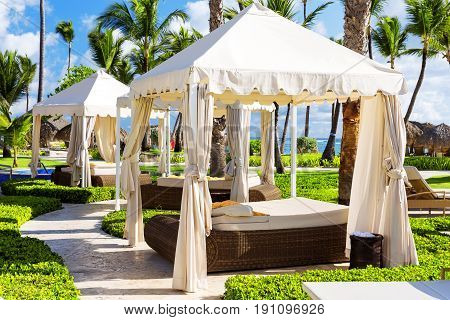 Tropical beach resort with umbrellas and lounge chairs in Punta Cana Dominican Republic