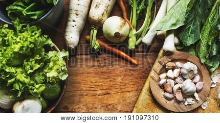 Cloves of garlic and diverse vegetable on the table