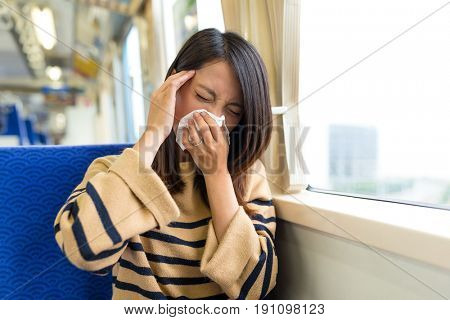 Woman feeling sick inside train compartment