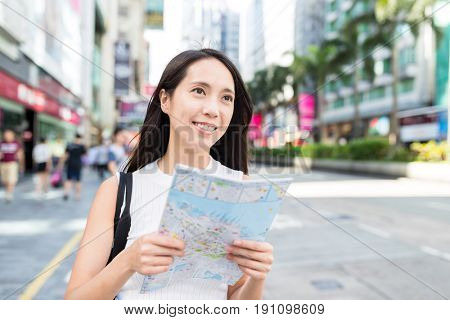 Woman travel in Hong Kong and using city map