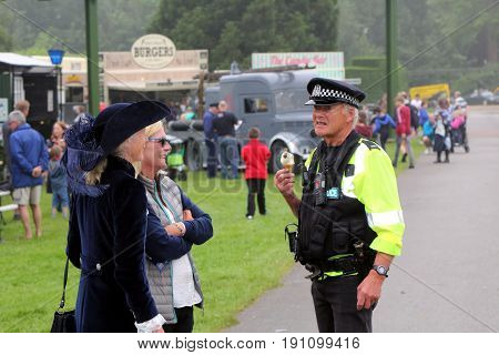 Beaulieu, Hampshire, Uk - May 29 2017: Uk Police Officer Talking To The Right Hon. Mary Montagu-scot