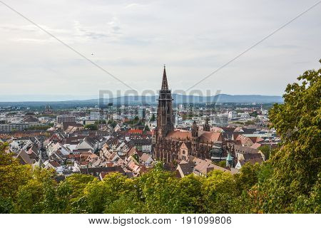 The old town and cathedral of Freiburg Germany from a hill