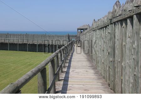 A wooden palisade of Fort Michilimackinac on the Straits of Mackinac, Michigan