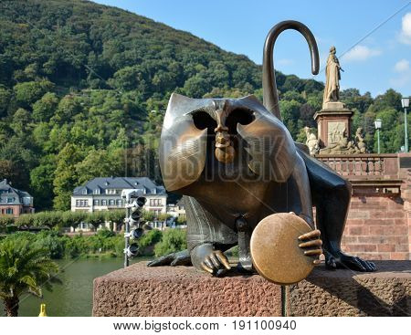 Metal Monky statue at the river and bridge in Heidelberg in the sun