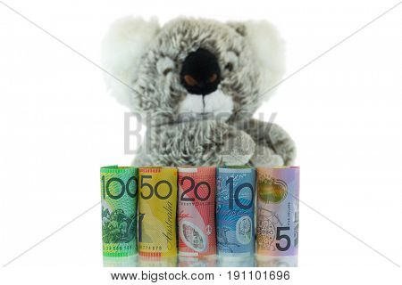 Rolls of Australia Banknote with blurred Koala background. Different Australian 5, 10, 20, 50, 100 dollars money isolated on white background