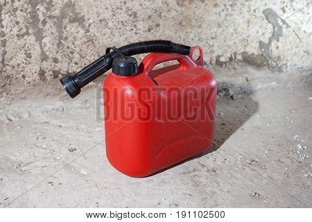 Canister red for combustible lubricants on a concrete background