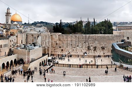 Jerusalem Israel - March 24 2011: View of the Western Wall the Dome of the Rock and the Mughrabi Gate on the Temple Mount in the Old City of Jerusalem. Western Wall in Jerusalem is a major Jewish sacred place