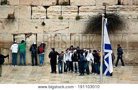 Jerusalem Israel - March 24 2011: Jewish prayers and pilgrims beside Western Wall