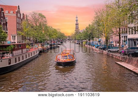 City scenic in Amsterdam the Netherlands at the Prinsengracht with the Westerkerk