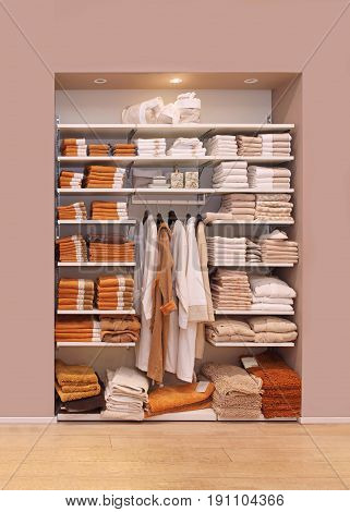 Large open closet full with towels and bathroom robes