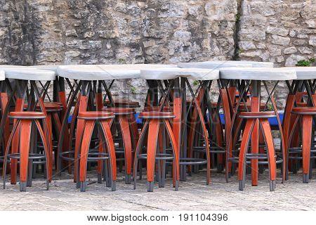 Tall chairs outside in summer bar garden