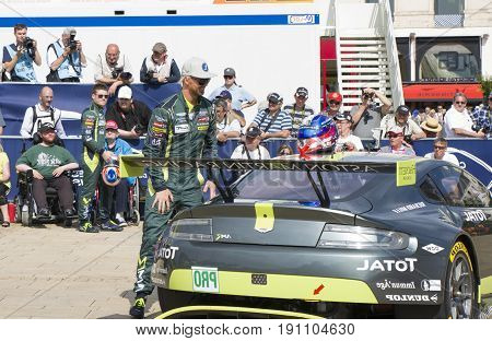 LE MANS, FRANCE - JUNE 11, 2017: Famous Danish racer Nicki Thiim with his race car Aston Martin. Weighing, administrative and technical checks of the race cars for competition 24 hours of Le mans circuit