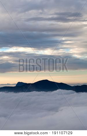 Mount over mist abstract background - Western Ghats mountain landscape in Munnar, Kerala, South India