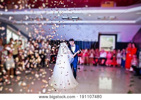 Touching And Emotional First Dance Of The Couple On Their Wedding With Confetti And Colorful Lights