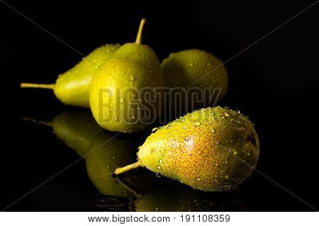 Group Of Pears With Falling Water Drops
