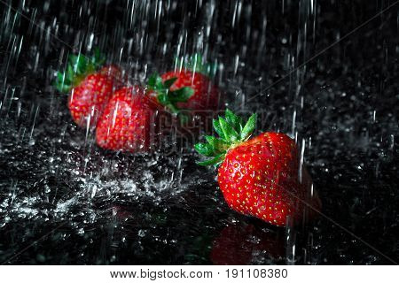 Group Of Strawberries With Falling Water Drops