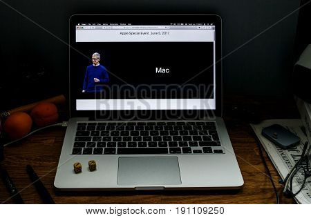 PARIS FRANCE - JUNE 6 2017: Apple Computers website on MacBook laptop in creative environment showcasing news from Apple at WWDC 2017 - New Mac by Tim Cook
