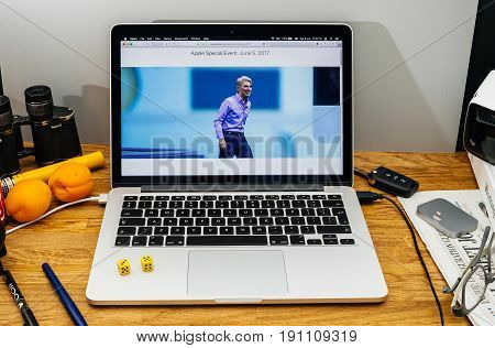 PARIS FRANCE - JUNE 6 2017: Apple Computers website on MacBook laptop in creative environment showcasing Apple Craig Federighi previews macOS High Sierra at WWDC 2017 - entering on stage of conference