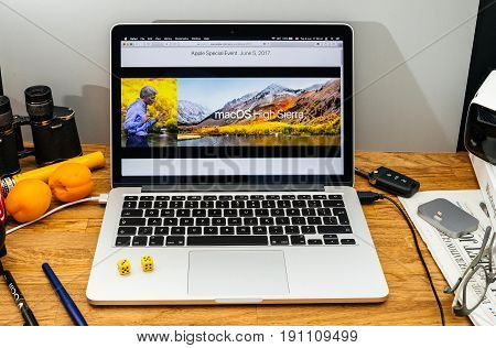 PARIS FRANCE - JUNE 6 2017: Apple Computers website on MacBook laptop in creative environment showcasing Apple Craig Federighi previews macOS High Sierra at WWDC 2017 - introduction of new OS name