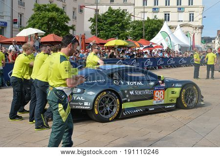 LE MANS FRANCE - JUNE 11 2017: Famous English racer Darren Turner with his team and Aston Martin Vantage racing car. Weighing administrative and technical checks of the race cars for competition 24 hours of Le mans circuit