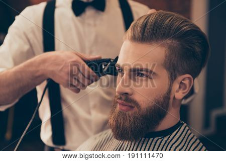 Close Up Of A Hairdresser`s Work For A Handsome Young Guy At The Barber Shop. He Is Doing Styling Wi