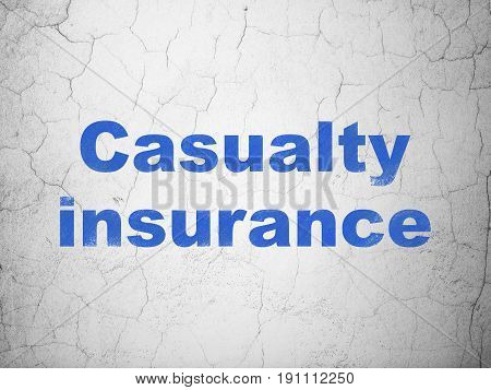Insurance concept: Blue Casualty Insurance on textured concrete wall background