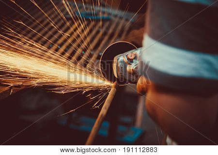 Sparks During Cutting Of Metal Angle Grinder. Close-up Saw Sawing A Steel. Soft Focus. Shallow Dof.