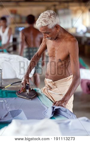 Indian People Working Hard On Dhobi Ghat In Fort Cochin, India