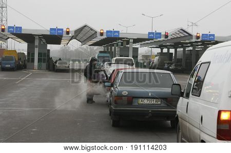 DOROHUSK/POLAND - DECEMBER 182008: Queue of cars waiting at the Polish-Ukrainian border crossing
