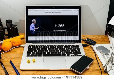 PARIS FRANCE - JUNE 6 2017: Apple Computers website on MacBook laptop in creative environment showcasing Apple Craig Federighi previews macOS High Sierra at WWDC 2017 - H265 High efficiency Video Coding