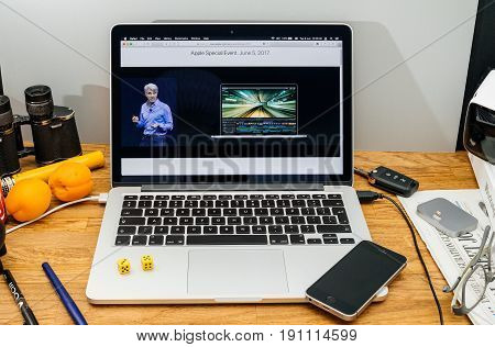 PARIS FRANCE - JUNE 6 2017: Apple Computers website on MacBook laptop in creative environment showcasing Apple Craig Federighi previews macOS High Sierra at WWDC 2017 - new video hardware and software