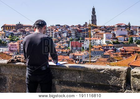 Artist drawing from a viewpoint of Porto Portugal.