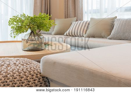Vast Of Plants On Wooden Round Table In Modern Living Room Design